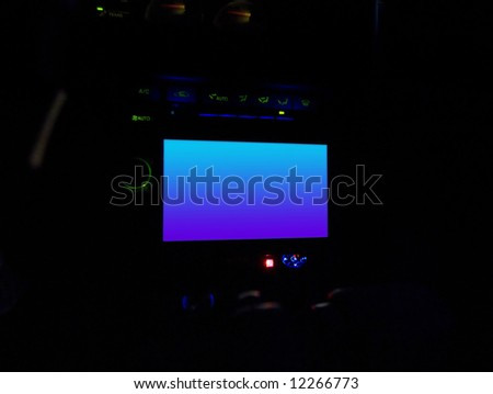 An in dash lcd screen commonly used for a navigation system or other in car entertainment.  This file includes a clipping path for the screen area. - stock photo