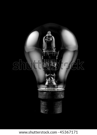 An incandescent light globe isolated against a black background