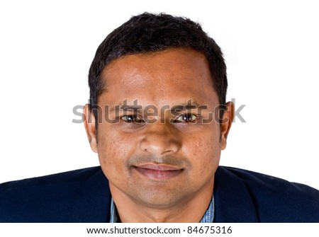 An indian / Asian business executive wearing a suit - looking up - isolated on white