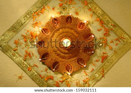 An Indian traditional, earthen lamp - stock photo