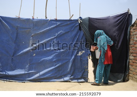 An Indian woman  her temporary  home. - stock photo