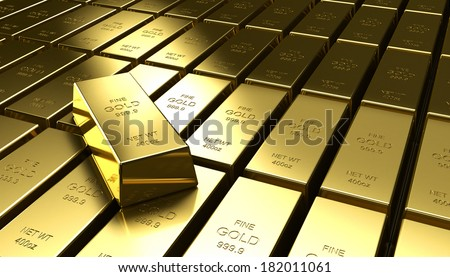 An individual gold bar on a stack of other gold bars