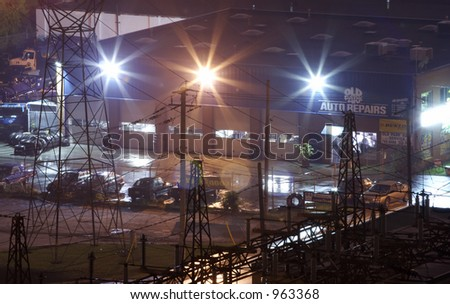 An industrial buiding at night with lights. - stock photo