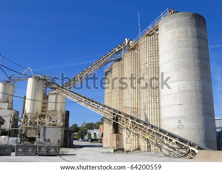 An industrial cement processing facility. - stock photo