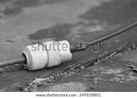 An industrial extension cord serves electrical equipment - stock photo