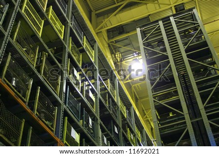 An industrial factory's on-site high rise parts storage warehouse. - stock photo