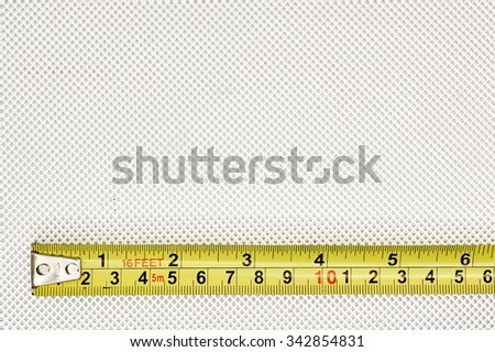 An industrial photo of a tape measure - stock photo