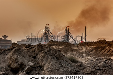 An industrial plant pollutes the air and produces hazardous waste in Baotou, Inner Mongolia, China. - stock photo