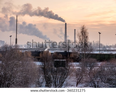 An industrial stack billows smoke into the air. - stock photo