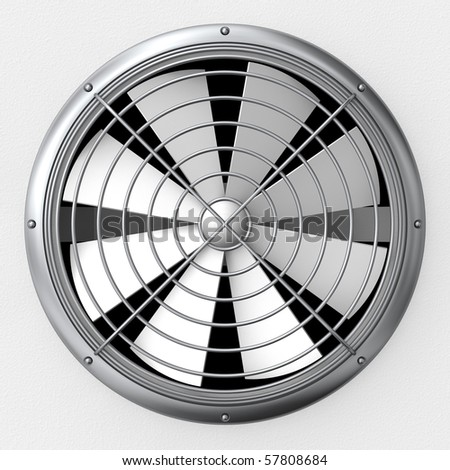 An industrial ventilation fan attached to a building with cage guard - stock photo