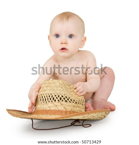An infant with a straw cowboy hat on a white background - stock photo