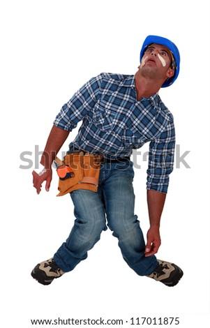 An injured tradesman - stock photo