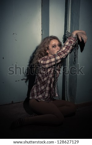 an insane psycho girl wearing a straight jacket. domestic violence. family problems and woman violence. - stock photo