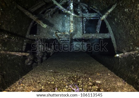 An inside look of the smokestack of the USCG Duane. A sunken shipwreck at the John Pennekamp State Park in Key Largo, Florida. A haven for technical divers. - stock photo