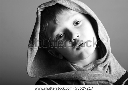 an insolent or nonchalent young boy in a hoodie