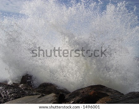 An instant of ocean water explosion. - stock photo