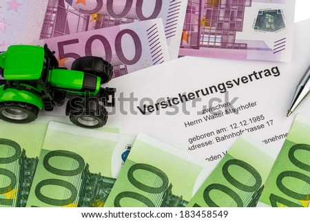 an insurance contract for new tractor. with euro money banknotes - stock photo