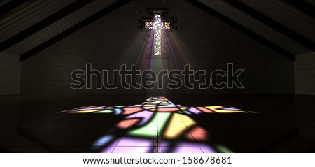 An interior building with a colorful stained glass window in the shape of a crucifix with a spotlight rays penetrating through it reflecting the image on the floor - stock photo