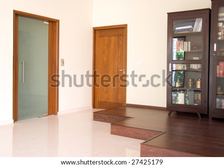 An interior of a home with book cupboard and doors