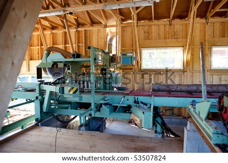 An interior of a small saw mill - stock photo