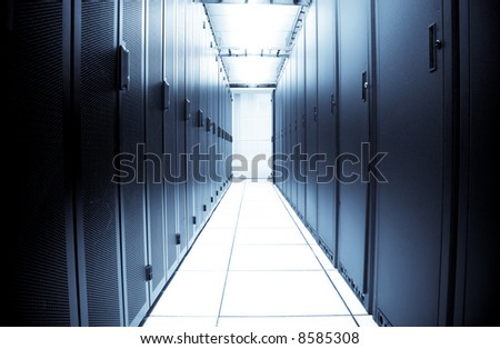 An interior shot of a computer data center (in blue tone) - stock photo