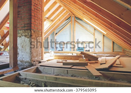 an interior view of a house attic under construction - stock photo
