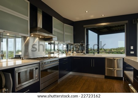 An interior view of a large, deluxe family kitchen - stock photo