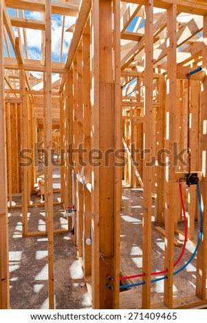 An interior view of a new home under construction with exposed wiring - stock photo