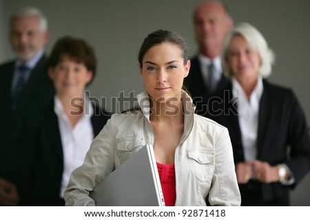 An intern posing with her superiors - stock photo