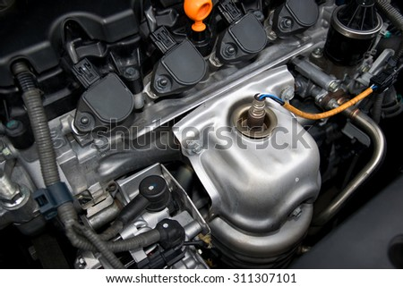 An internal combustion engine or electric motor and able to carry a small number. - stock photo