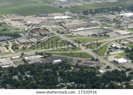 An interstate cutting through the heart of a green Midwestern town. - stock photo