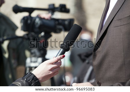 An interview for television - stock photo