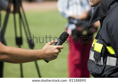 An interview with a firefighter - stock photo