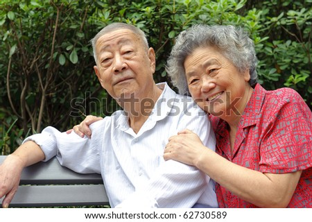 an intimate senior couple - stock photo