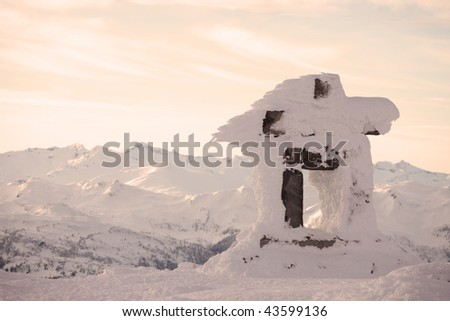 An inuksuk standing in the late afternoon light on Whistler Mountain. - stock photo