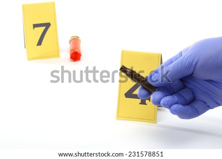 An investigator collect fired cartridge - stock photo