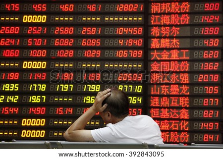 An investor watchs electric board in a stock market in Huaibei, Anhui province, east China on September 7 2015. - stock photo