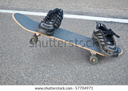 An invisible skateboarder riding a skateboard, only his shoes can be seen, where the rest of his body is transparent.