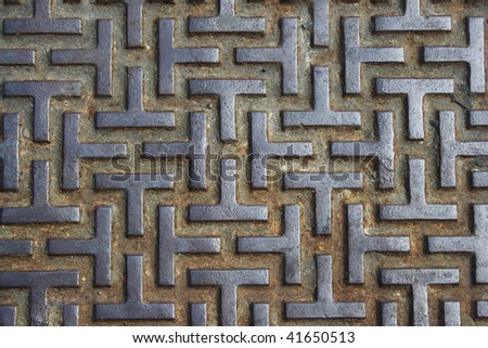 An Iron pattern that forms a maze.  It looks harsh and strong and would be ideal for a background that emphasis strength/grunge. - stock photo