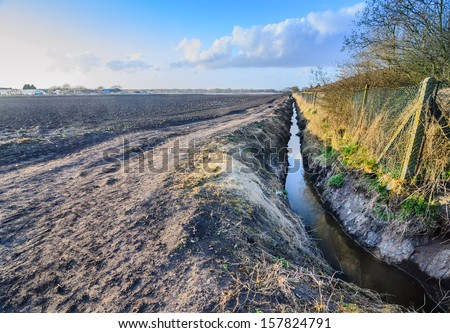 An irrigation ditch, or storm drain