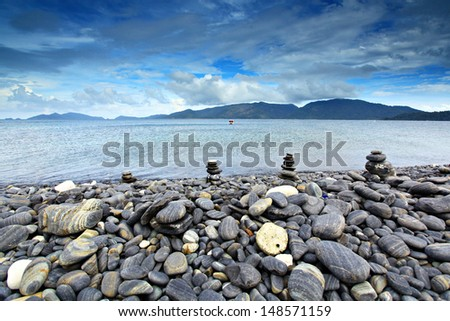 An island of smooth polished rocks in formation, a tourist attraction near Koh Lipe (aka Ko Lipeh), Thailand, part of Tarutao National Park  - stock photo