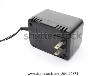 An isolated AC - DC Adapter on white background - stock photo