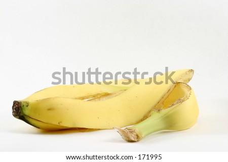 An isolated banana peel, minus the banana. - stock photo