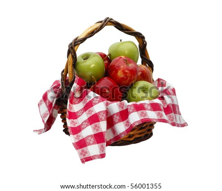 An isolated basket of green and red apples with a red and white checkered cloth. - stock photo