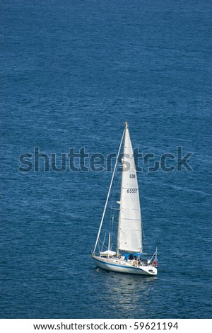 An isolated boat inside a big ocean - stock photo