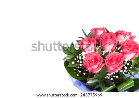 An isolated bouquet of pink red roses in the corner. A gift for a woman for a valentine's day - stock photo