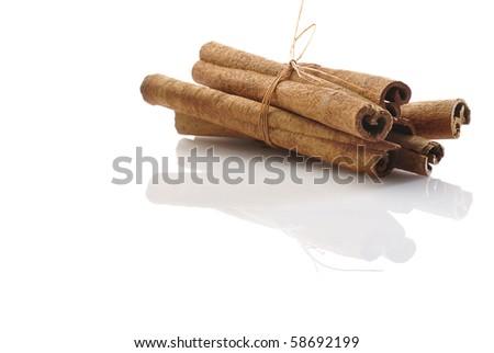 An isolated bunch of cinnamon sticks. - stock photo
