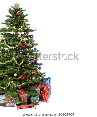 An isolated Christmas tree ready for Santa. - stock photo