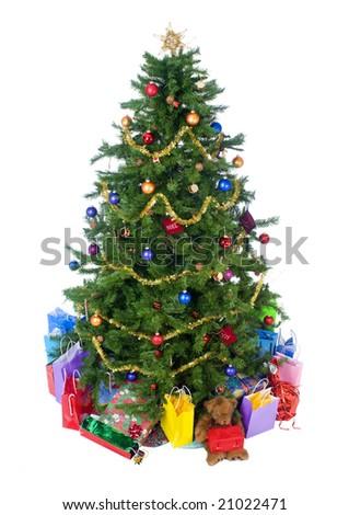 An isolated Christmas tree ready for Santa. - stock photo
