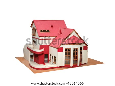 An isolated cottage mock up (scale model) on a white background - stock photo
